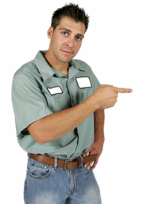 a young man, dressed as a propane technician points to the right with his finger. He is pointing to the Propane Blog section of the home page.